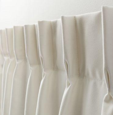 Tête de rideaux à plis